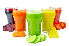 Juice vegetable in five glasses with vegetables Royalty Free Stock Photo