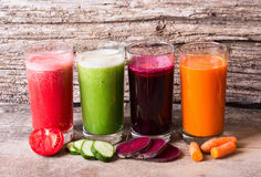 Juice. With vegetables ( carrots, beets, tomatoes and cucumbers Stock Images