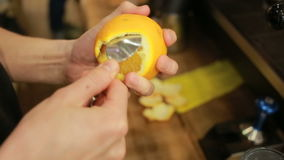 Juicer. Fresh orange juice. Barista squeezes the juice from fresh oranges. stock video footage