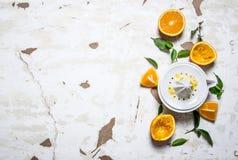 Juicer with fresh oranges. The fresh orange juice. Royalty Free Stock Image
