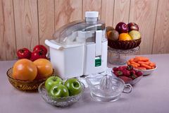 Juicer with fruit Royalty Free Stock Images