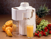Juicer with glass and fruit Royalty Free Stock Photo
