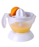 Juicer with juice and an orange half Stock Photos