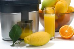 Juicer with lemons and oranges Royalty Free Stock Photo