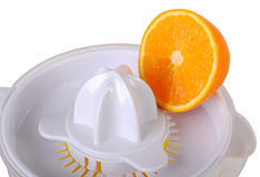 Juicer and an orange half Royalty Free Stock Image