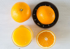 Juicer and orange Royalty Free Stock Images