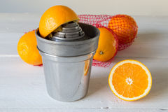 Juicer and orange Stock Photography