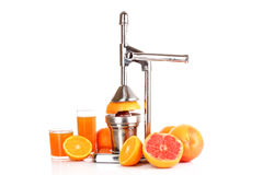 Juicer and oranges stock images