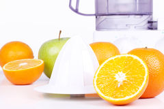 Juicer, oranges and green apple Royalty Free Stock Image