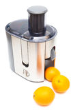 Juicer and oranges Royalty Free Stock Photos
