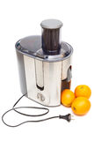 A juicer and oranges Stock Photos