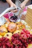Juicer and pomegranate juice Stock Photo