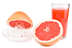Juicer, sneed een grapefruit en een glas sap. Stock Fotografie