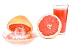 Juicer, sneed een grapefruit en een glas sap. Royalty-vrije Stock Fotografie