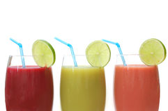 Juices. Selection of different juices with a slice of lime stock images