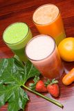Juices. Juice of fresh fruit and vegetables on table Stock Photo