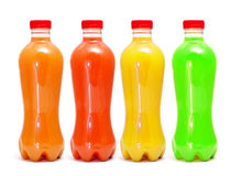 Juices. Some bottles of different colors with different juices on a white background stock photos