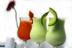 Juices. Three glass of juices on the table royalty free stock photo
