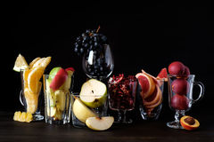 Juices. Assorted fruit. Still life of juices, whole fruits depicted Stock Photos