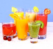 Juices from cherry, orange, strawberry, kiwi and banana Stock Photo