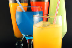 Juices of different colors close up Royalty Free Stock Images