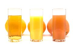 Juices and Fruits. Citrus Fruits with Different Juices Stock Images