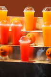 Juices into glass and plastic. Placed on the market Stock Photos