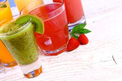 Juices, kiwi, raspberries, cherry, orange, strawberry Stock Image