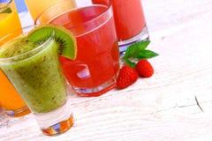 Juices, kiwi, raspberries, cherry, orange, strawberry Stock Image