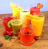 Juices, kiwi, raspberries, cherry, orange, strawberry and pineapple Royalty Free Stock Image