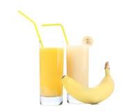 Juices of orange and banana. Fruits. Royalty Free Stock Photos