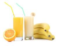 Juices of orange and banana. Fruits. Royalty Free Stock Image