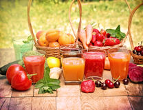 Juices and smoothies. Juices, smoothies, fruits and vegetables on table stock photo