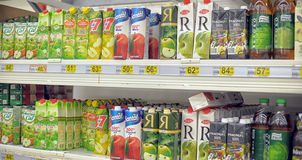 Juices on the supermarket shelf Royalty Free Stock Images