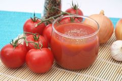 Juices of tomatoes Stock Photography