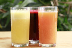 Juices. Tree juices on the table, healthy drink royalty free stock images