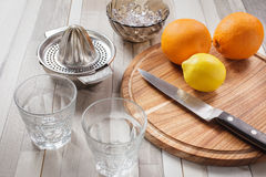 Juicing fresh from the oranges and lemon Royalty Free Stock Images