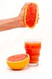 Juicing a grapefruit Stock Photo