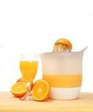 Juicing oranges Royalty Free Stock Photo