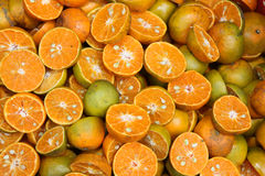 Juicing Oranges. Oranges cut in half ready for juicing. Street market, Thailand Royalty Free Stock Images