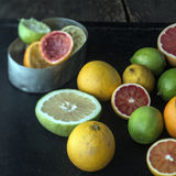 Juicing a selection of fresh citrus fruit Stock Photography