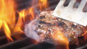Juicy appetizing meat for a Burger is turned over on the grill with a spatula. Juicy meat for a Burger is turned over on the grill with a spatula stock video