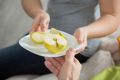 Juicy apple on the plate Royalty Free Stock Images