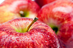Juicy apples in drop of water Royalty Free Stock Photos