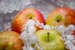 Juicy apples on a floral background gray stock photo