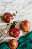 Juicy apples, marble table Royalty Free Stock Images