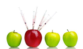 Juicy apples and syringes Stock Photos