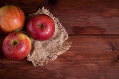 Juicy apples on a wood desk Stock Photos