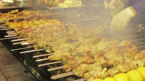 Juicy barbecue preparing on brazier. Street food festival. Appetizing meal. Stock footage stock footage