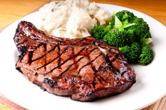 Juicy bbq rib steak with garlic mashed potatoes Stock Image